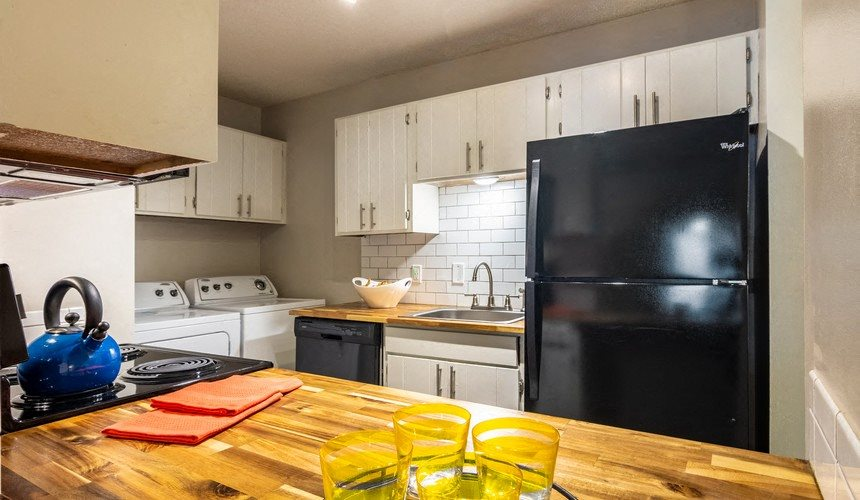 Spacious kitchen with black energy efficient appliances at Hawthorne Creekside