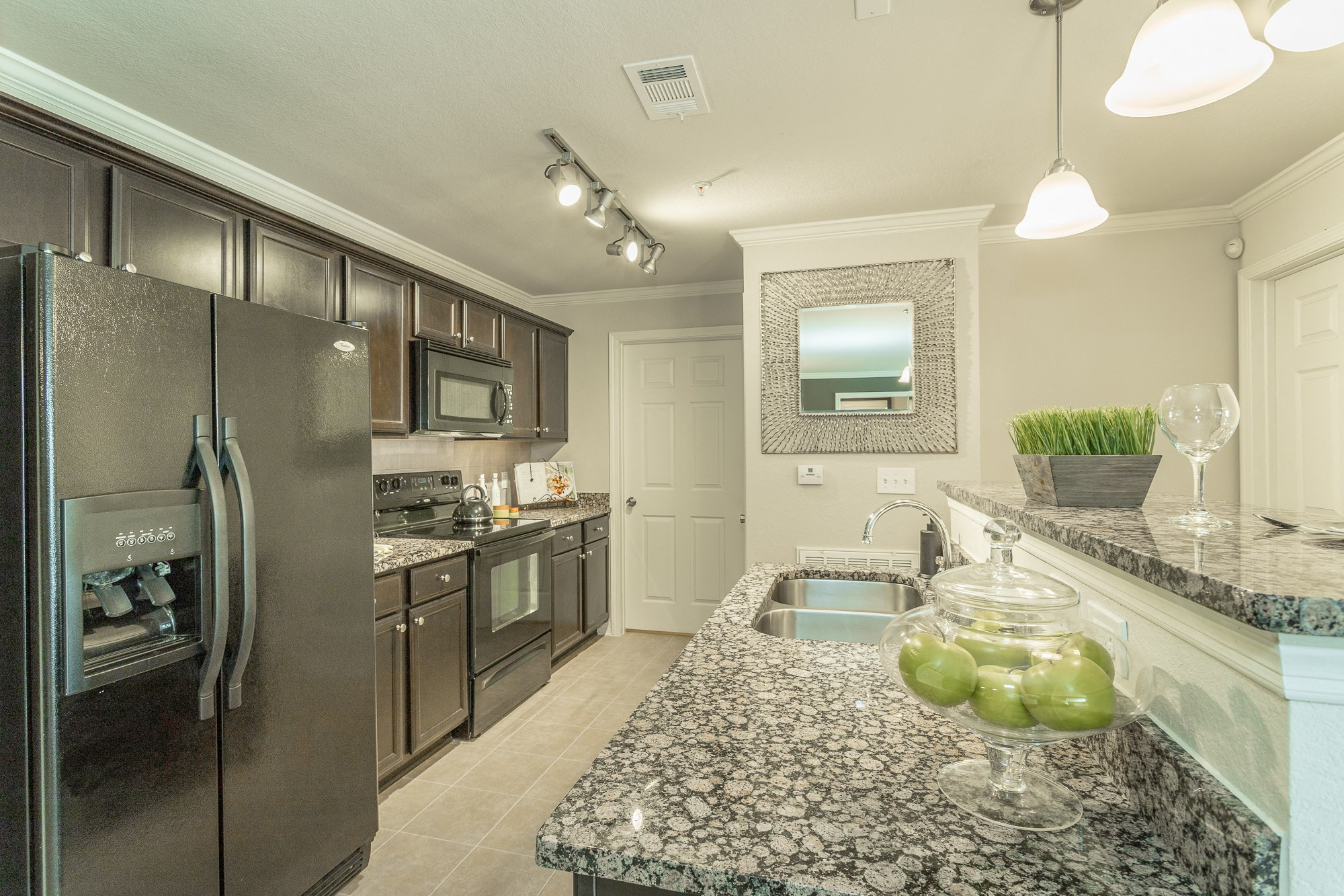Beautiful kitchen with black energy efficient appliances and granite countertops at Amberleigh Ridge