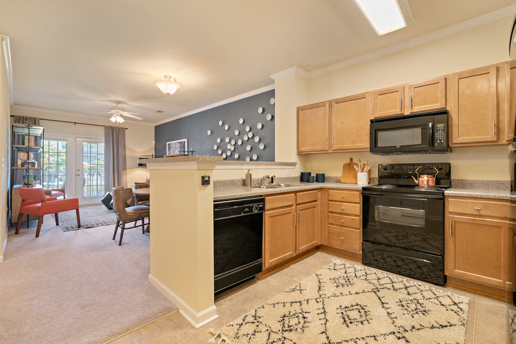 Spacious kitchen with energy efficient black appliances at Hawthorne at Horse Pen Creek