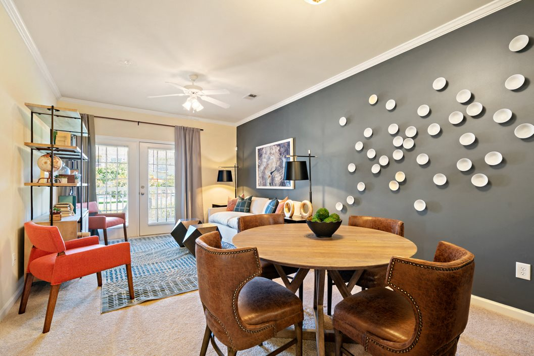 Dining room at living room areas in your home at Hawthorne at Horse Pen Creek