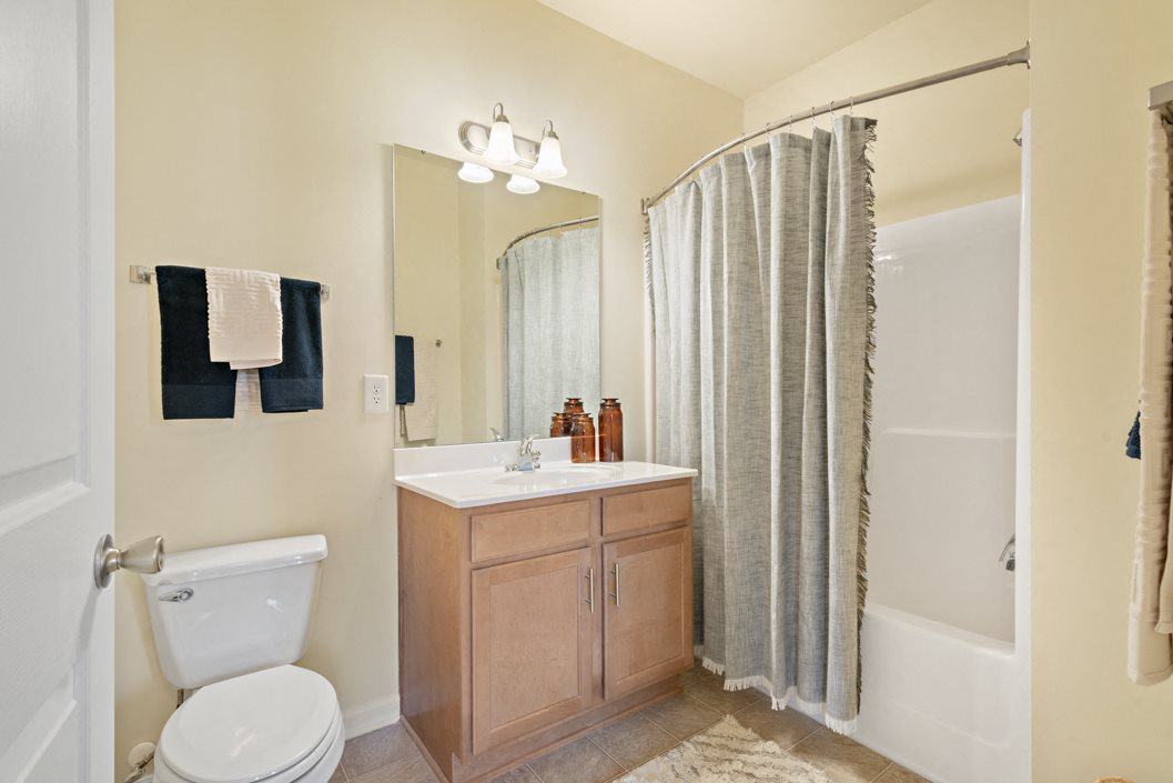 Spacious bathroom with under-sink storage at Hawthorne at Horse Pen Creek