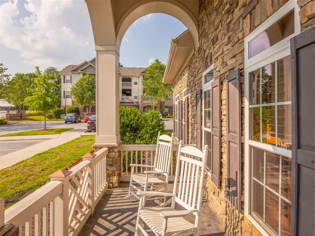 Relax on the patio of the Hawthorne at the Meadows Clubhouse