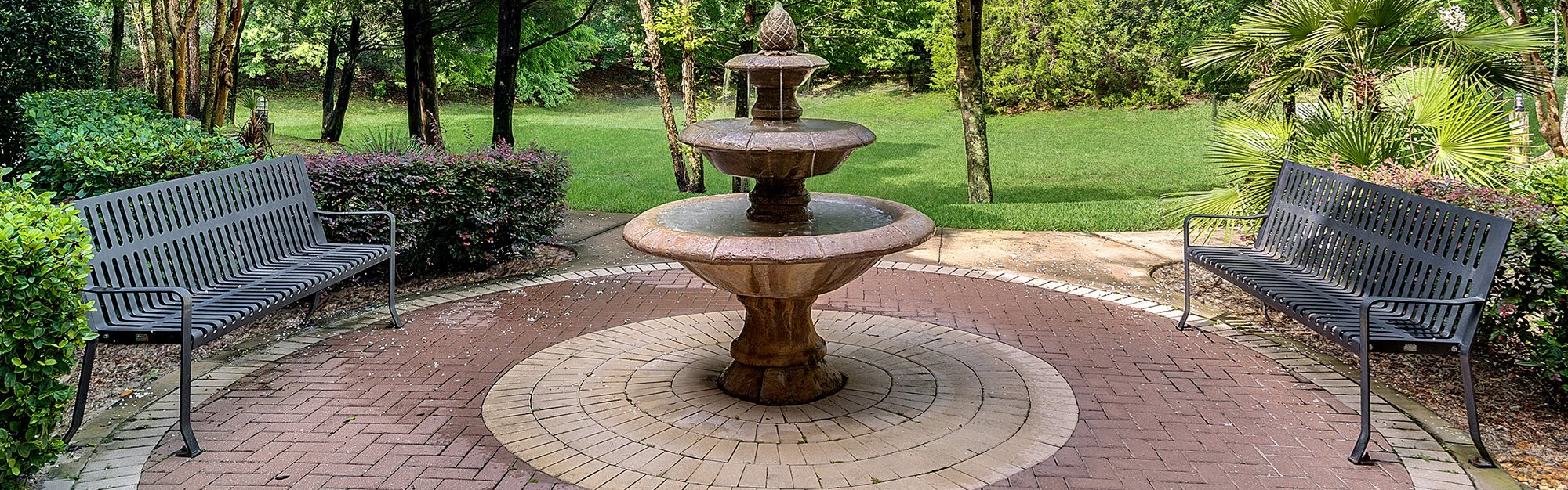 Rolling Acres Apartments for rent in Tampa, FL. Make this community your new home or visit other Concord Rents communities at ConcordRents.com. Outdoor sitting area with fountain
