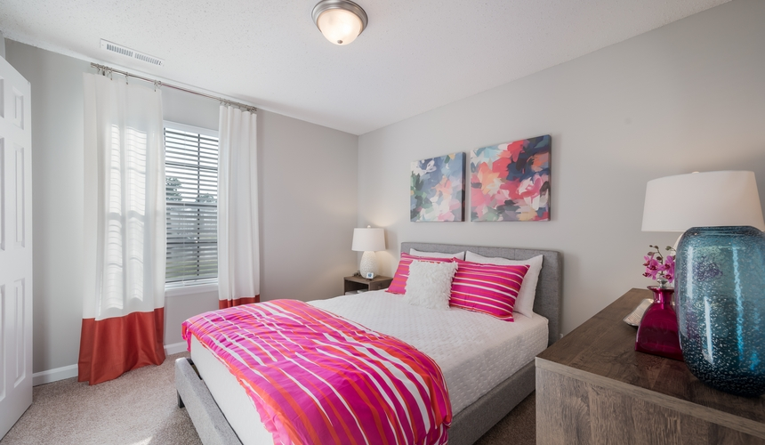 Beautiful bedroom at Hawthorne at the Ridge with plush carpeting and large windows