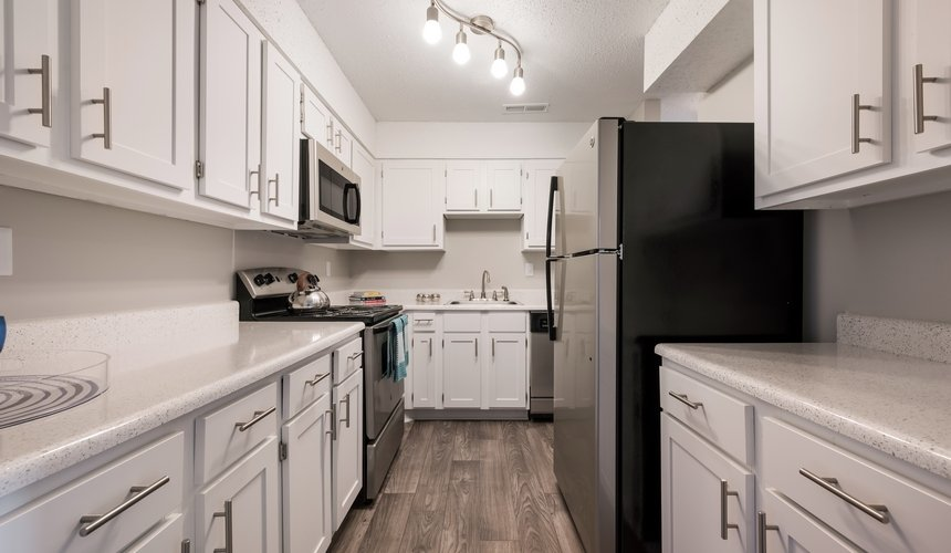 Spacious kitchen with white cabinetry and stainless steel appliances at Hawthorne at the Ridge