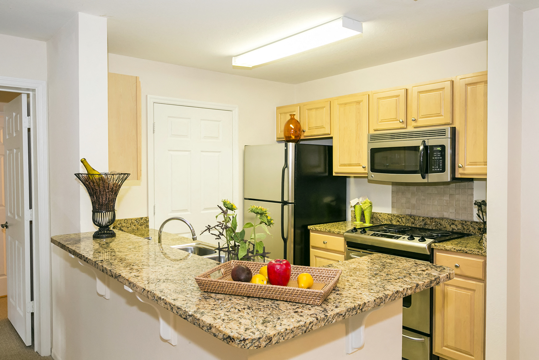 Enterprise Cove Condos for rent in Orange City, FL. Make this community your new home or visit other Concord Rents communities at ConcordRents.com. Kitchen