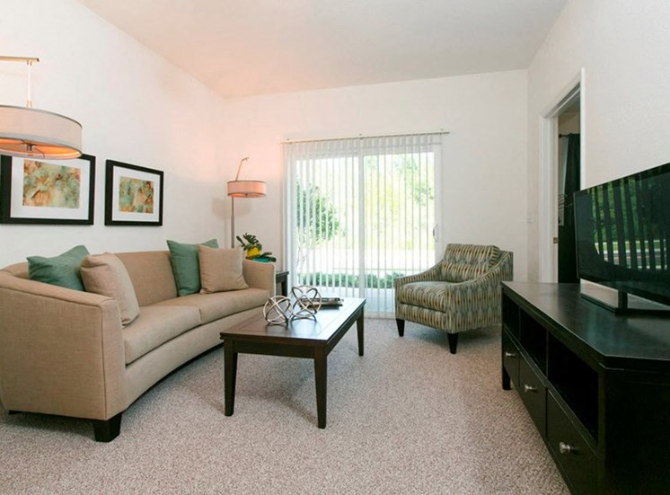 Palm Coast Landing Senior Living Apartments for rent in Palm Coast, FL. Make this community your new home or visit other Concord Rents communities at ConcordRents.com. Living room