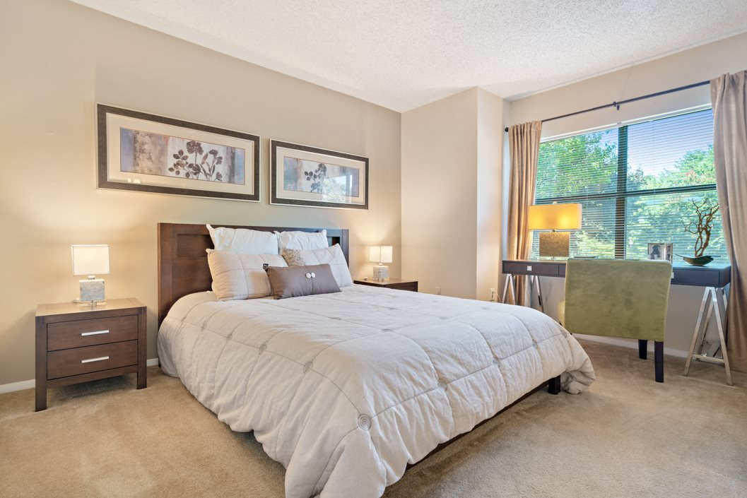 Beautiful bedroom with plush carpeting and large windows at Hawthorne at Southside