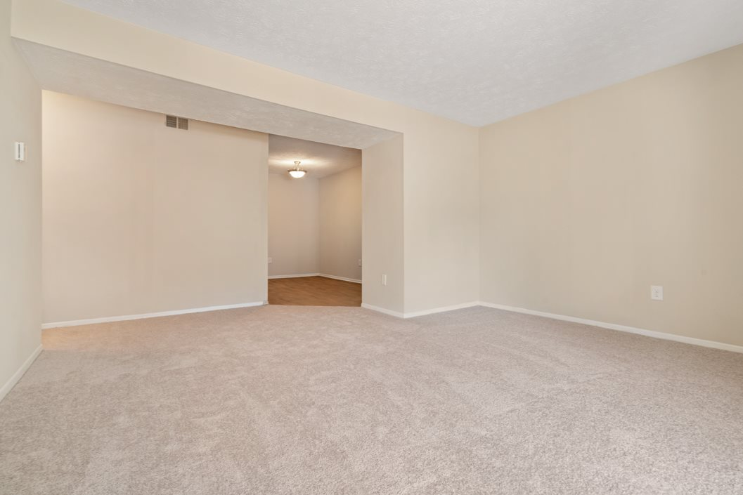 Spacious bedroom with plush carpeting at Hawthorne at Southside