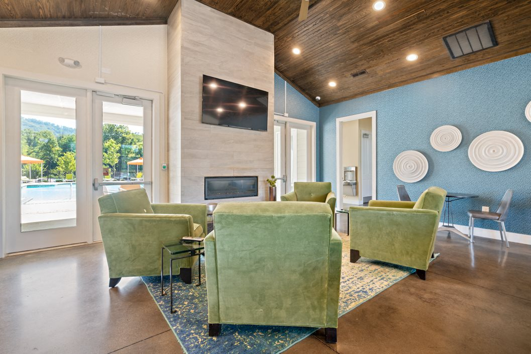 Gather around the fireplace inside the clubhouse at Hawthorne at Southside