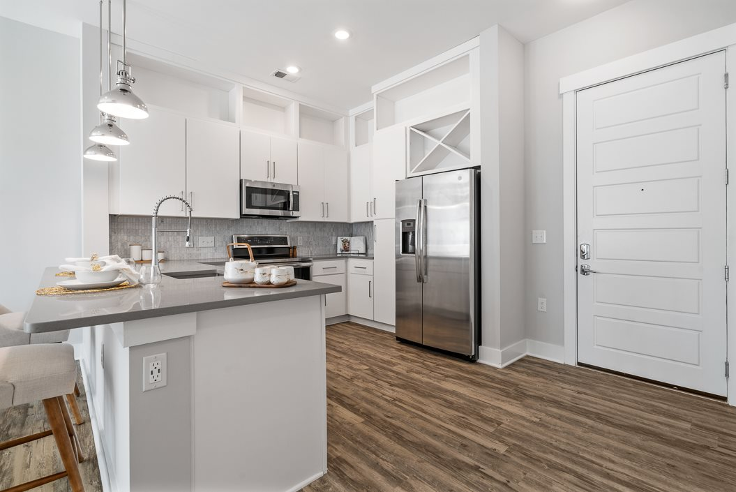 Huge kitchen with breakfast bar and wood flooring hawthorne at friendly