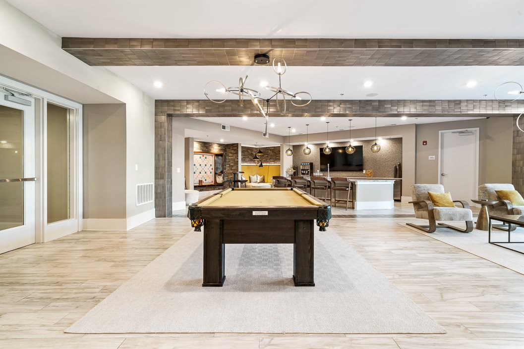 Pool table in resident clubhouse at hawthorne at friendly apartments