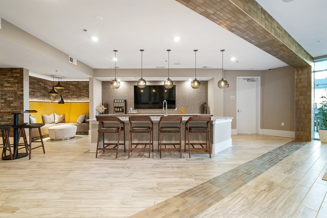 Resident Lounge with demo kitchen Hawthorne at Friendly
