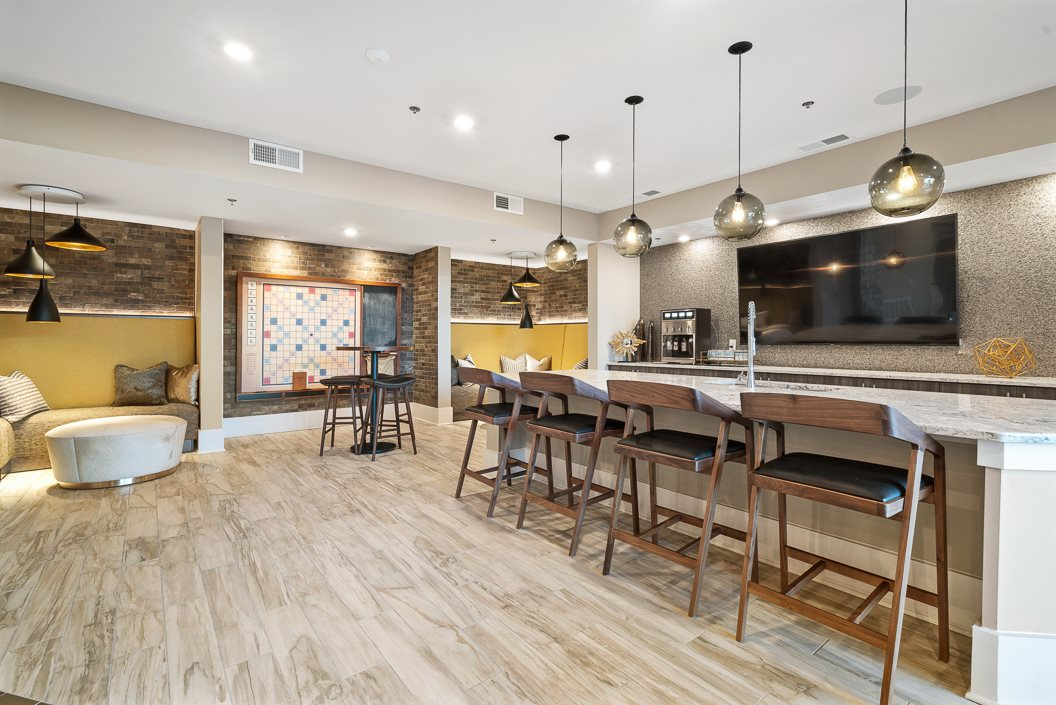 Stylish resident lounge with demo kitchen and large scrabble board Hawthorne at Friendly Greensboro NC