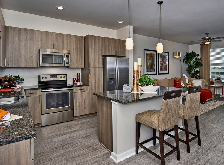 Enclave at Cherry Creek - Gourmet kitchens with Whirlpool stainless steel appliances