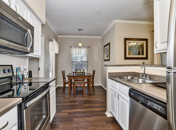 Grand Centennial Apartments upgraded kitchen with stainless steel appliances