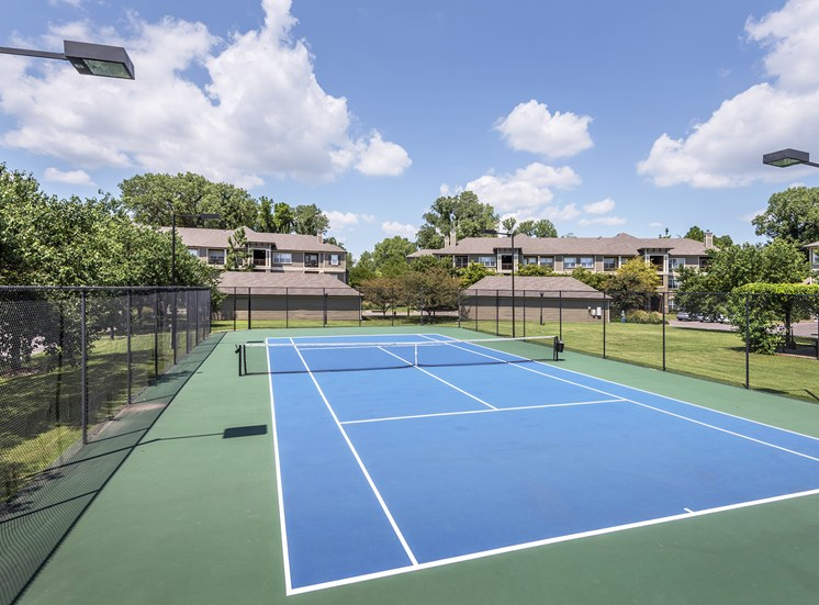 The Estates at River Pointe - Lighted tennis court