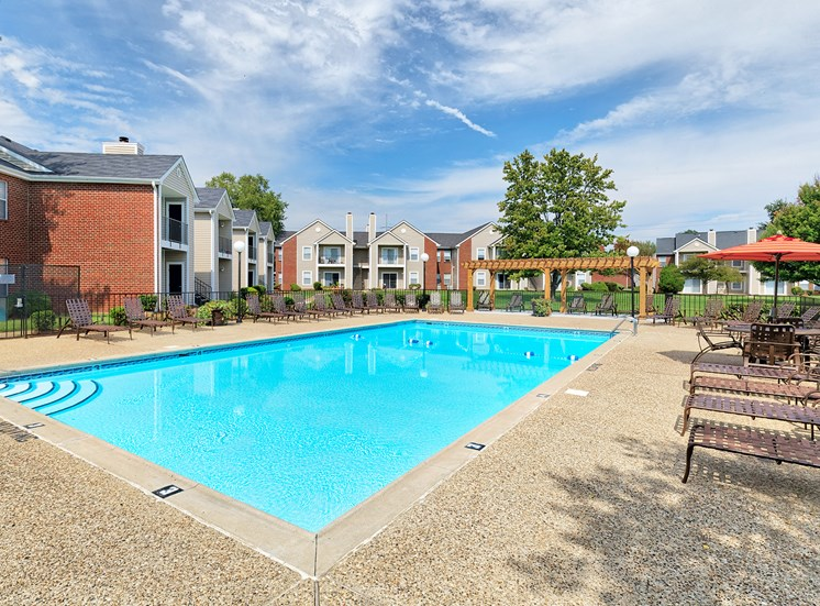 East Chase Apartments - Outdoor swimming pool with lounging area