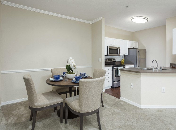 Andover Place at Cross Creek Apartments - Staged dining area and kitchen