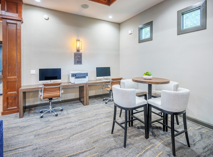 Lodge at Cypresswood Apartments - Business center with Mac and PC computers