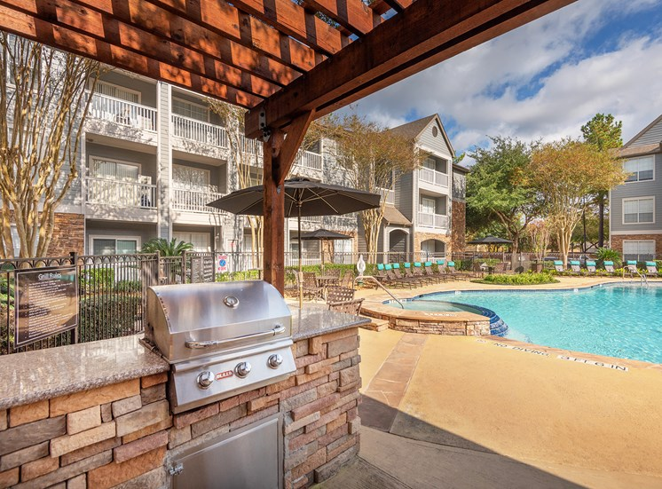 Lodge at Cypresswood Apartments - Poolside BBQ grills