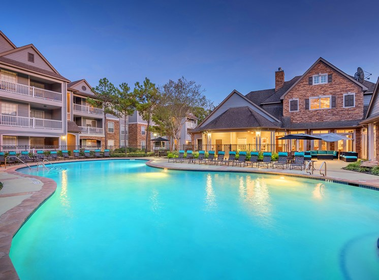Lodge at Cypresswood Apartments - Pool with sundeck at twilight