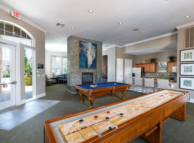 Cordillera Ranch Apartments - Game room with shuffle board and billiards table