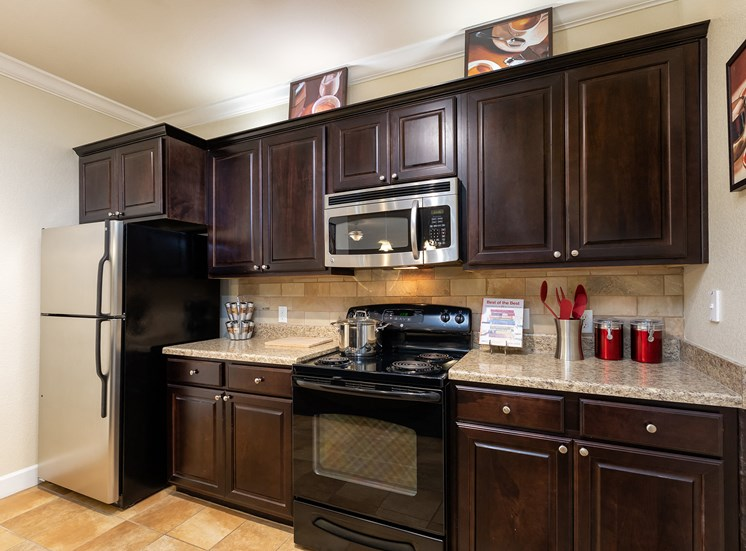 DeLayne at Twin Creeks espresso wood cabinetry