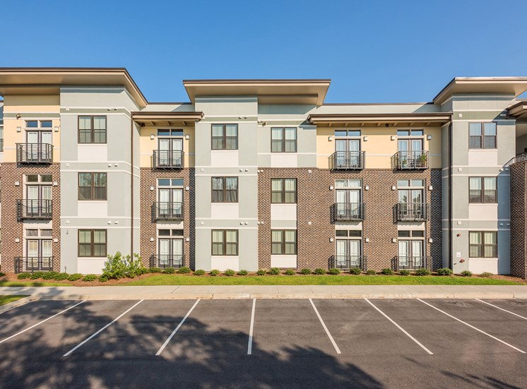 Centre Pointe Apartments - Building exterior with ample parking