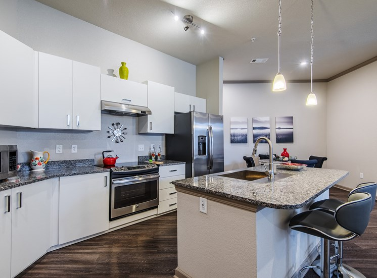 Centre Pointe Apartments white imported cabinetry from Italy and granite countertops