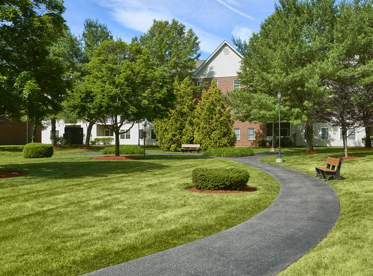 Hampshire Green Apartments - Manicured landscape and pathway