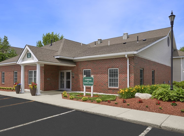 Hampshire Green Apartments - Leasing center exterior - with ample parking