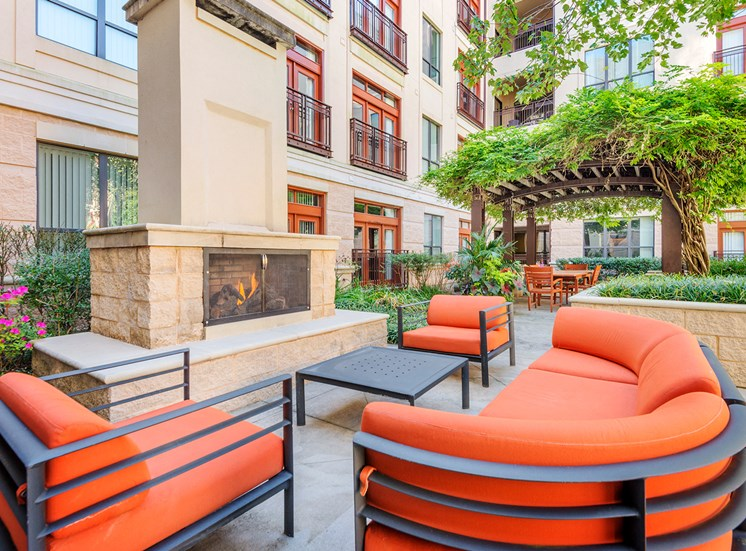 Lofts at Lakeview Apartments - Outdoor fireplace with seating