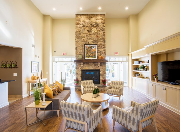 Avenel at Montgomery Square - Resident clubhouse with fireplace