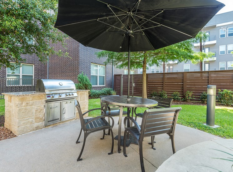 AVANT on Market Center - Outdoor grilling station with seating