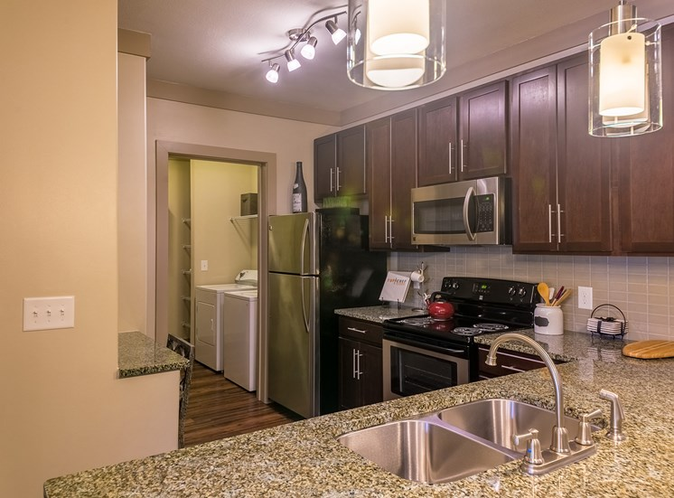 The Oaks at Johns Creek spacious kitchens with cherry cabinetry and granite countertops
