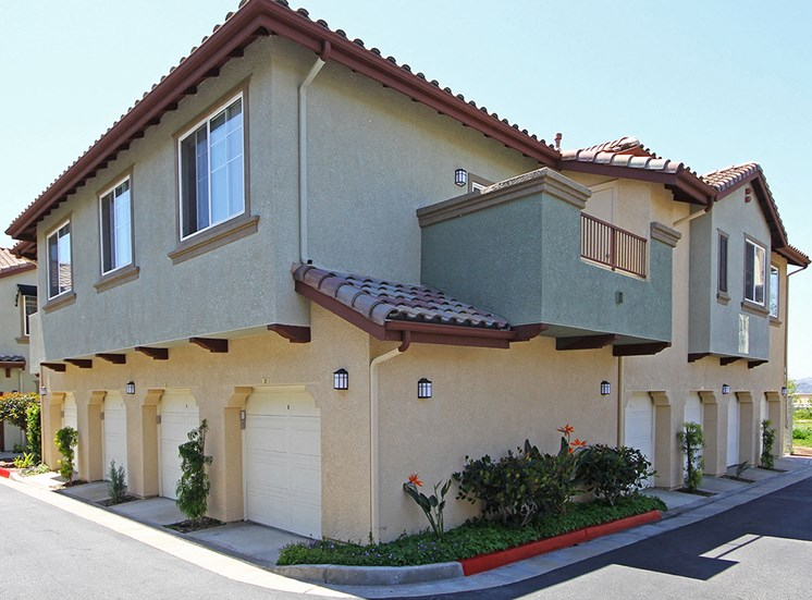 Exterior with garages at Hills of Valencia apartments