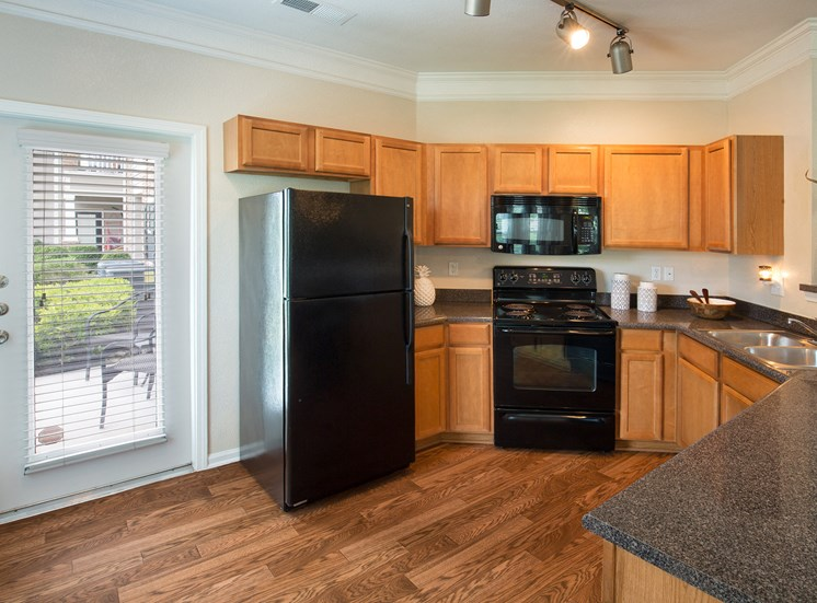 Carrington Place at Shoal Creek - Gourmet kitchen with black appliances