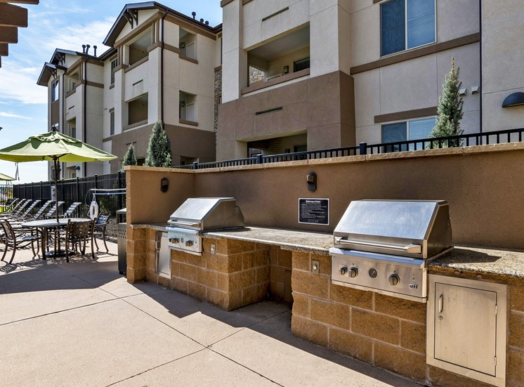 First and Main Apartments BBQ grills with seating area