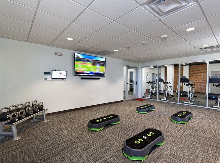 Fitness area with Wellbeats for The KC High Line Apartments in Kansas City, MO