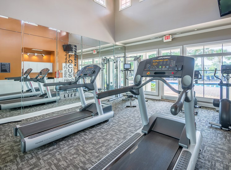 Fitness center with pool and lake views