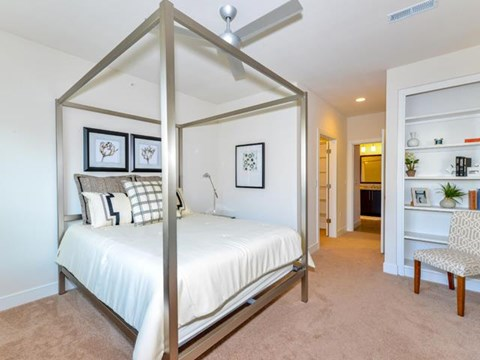 Bedroom with Built-In Storage and Ceilings Fans at Vanguard Crossing Apartments, University City, MO 63124