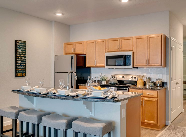WaterVue at Longwood Apartments for rent in Longwood, FL. Make this community your new home or visit other Concord Rents communities at ConcordRents.com. Lake view kitchen
